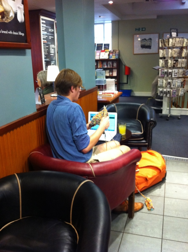 Young Man Knitting in Blackwell's
